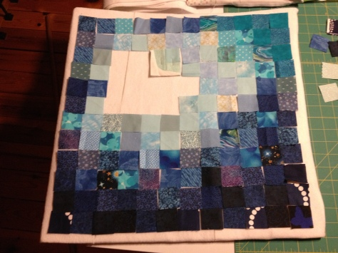 "After cutting all the 1.5"" squares, the next task was to lay it all out and find a pleasing gradient."