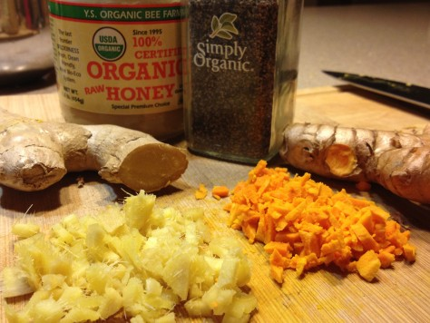 Fresh ginger, fresh turmeric, organic honey & black pepper. Not shown (but essential!): juice of half a lemon.