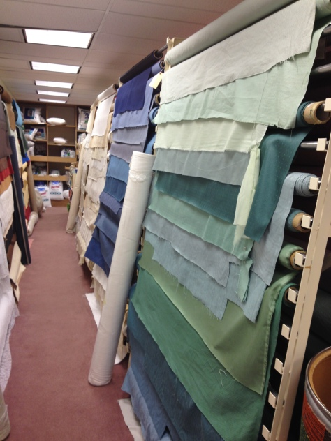 The lowest level was filled with large rolls of batting and rows of upholstery fabric.