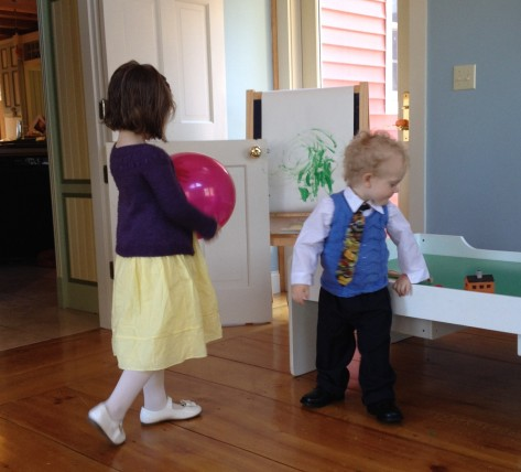 Blurry sweatered kids playing before Easter brunch.