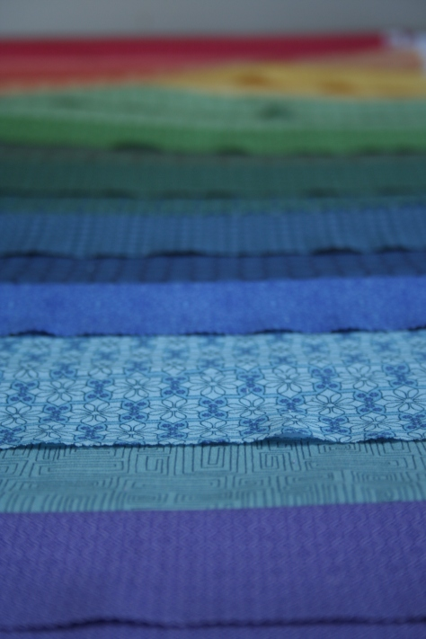 Depth of field rainbow jellyroll quilt