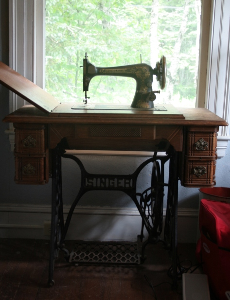 Singer treadle sewing machine and table in vacation bedroom