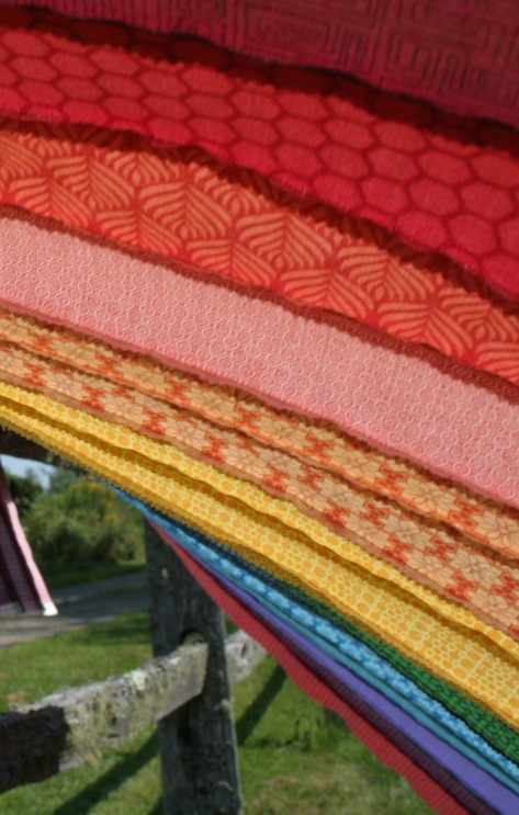 rainbow jellyroll quilt top