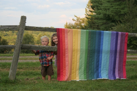 helpful kids and a rainbow jellyroll quilt