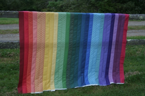 shaded rainbow jellyroll quilt