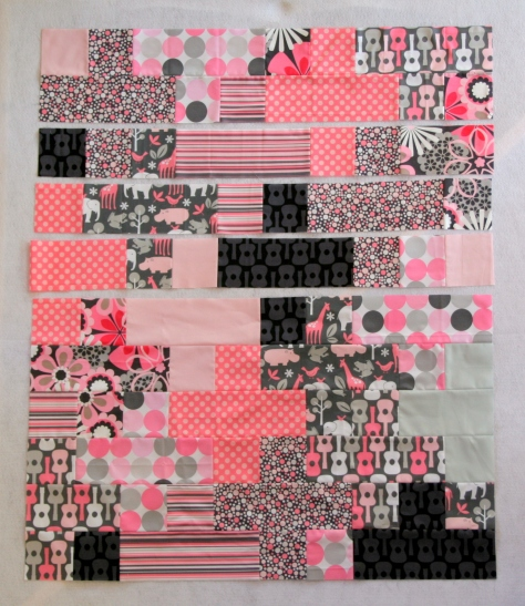 pink and gray baby plus quilt