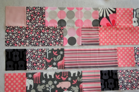 pink and grey baby plus quilt