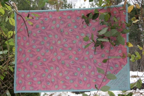 Quilt back with corner label.