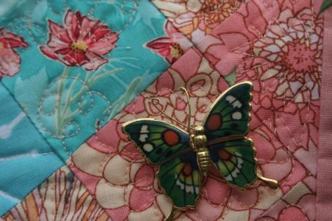 butterfly pins on garden quilt