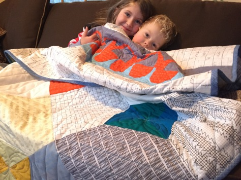 snuggling in the finished quilt
