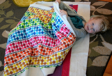 my little helper in the rainbow jellyroll quilt