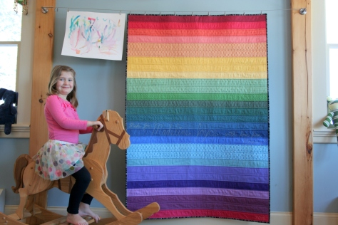 rainbow jellyroll quilt and maddie