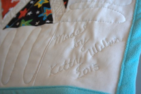 quilt label free motion quilted