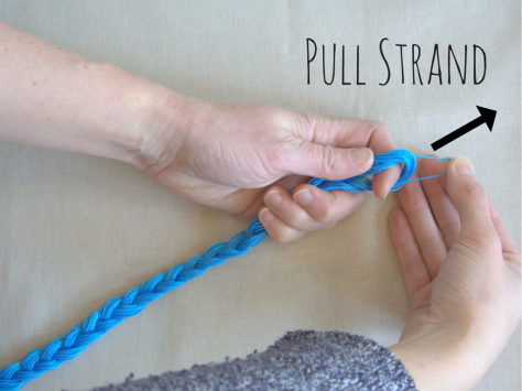 Pull strand of embroidery floss out of braid