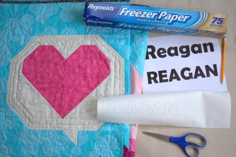 relief quilting of words in matchstick quilting with freezer paper