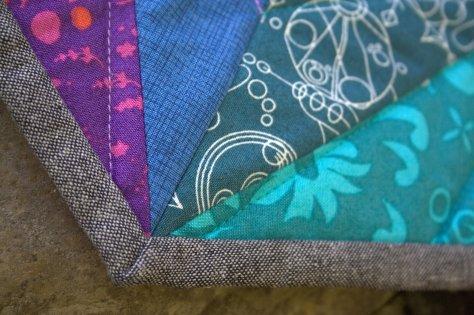 alison glass prismatic medallion roygbiv mini quilt finish
