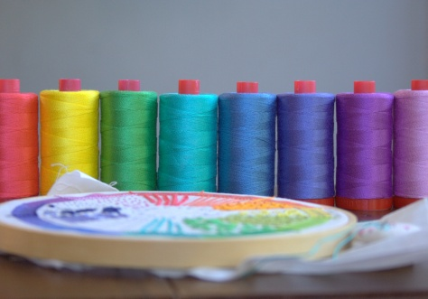 rainbow of aurifil 12wt thread and dropcloth sampler