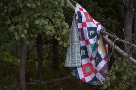 welded quilt in a tree