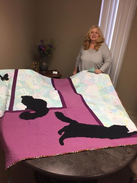 J with her quilt happy recipient