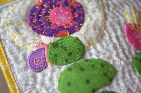 slow growth mini mini quilt finish snail detail