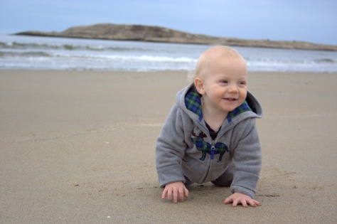 baby crawling on beach