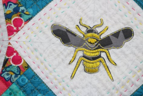 applique embroidered bee from alison glass fabric constant flux detail
