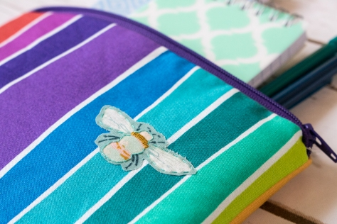 buzz bumble rainbow zip pouch