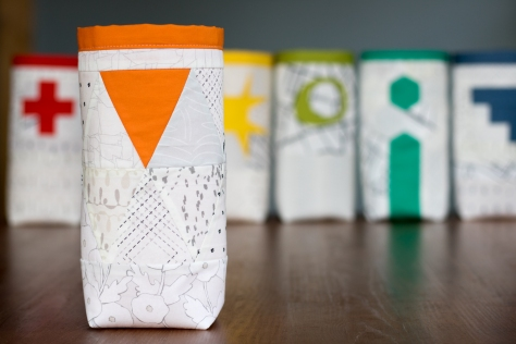 Fabric skinny bin AGF lower the volume capsule orange triangle