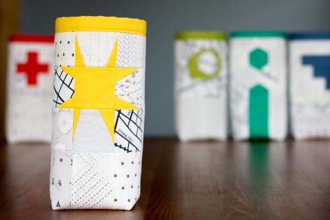 Fabric skinny bin AGF lower the volume capsule yellow wonky star