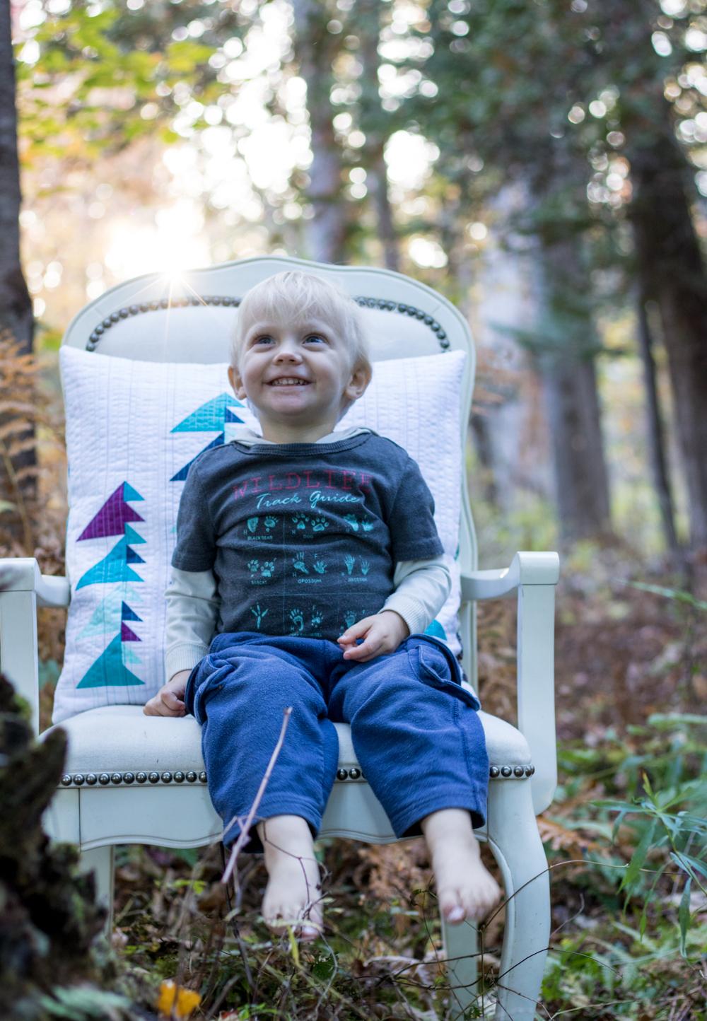 2 year old pillow photo shoot helper