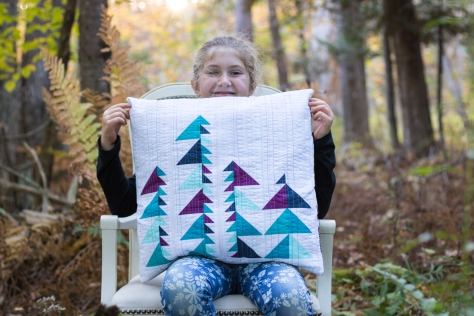 7 year old pillow photo shoot helper