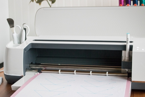 Cricut Maker in action drawing and cutting
