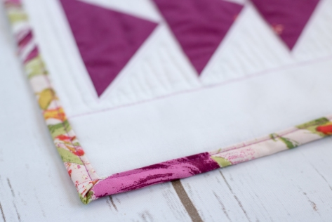 binding close up flying geese table runner