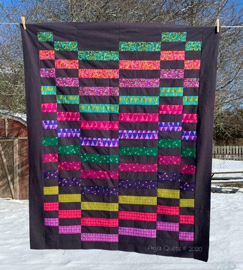 anja clyke staggered alison glass dark background quilt